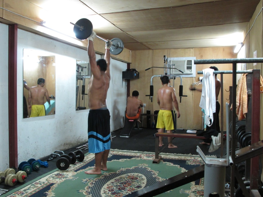 Workers spending energy after work and train in the self funded gym hall (Qatar 2010).