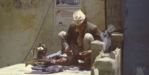 A Nepali tailor found a place to work for his numerous country-fellows porters (Mussoorie, India, 2003)