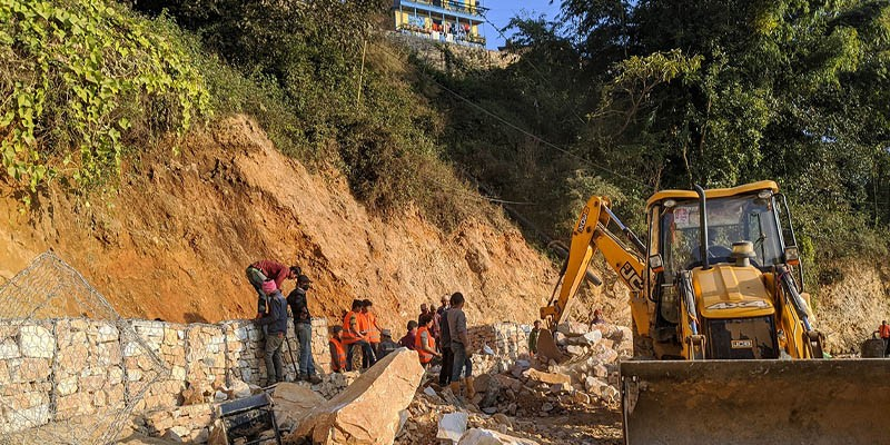 Migrant workers from Jajarkot, Salyan, Kalikot and Baitadi districts constructing gabion walls at a road construction site in Myanglung, Terhathum.