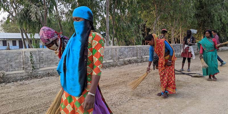 Women workers dusting the road before laying bitumen for Otta Seal surfacing in Mahottari_2019.jpg
