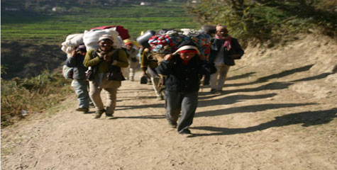 Migrant  workers return to the western hills of Nepal from India. This photo was taken in Bajura.