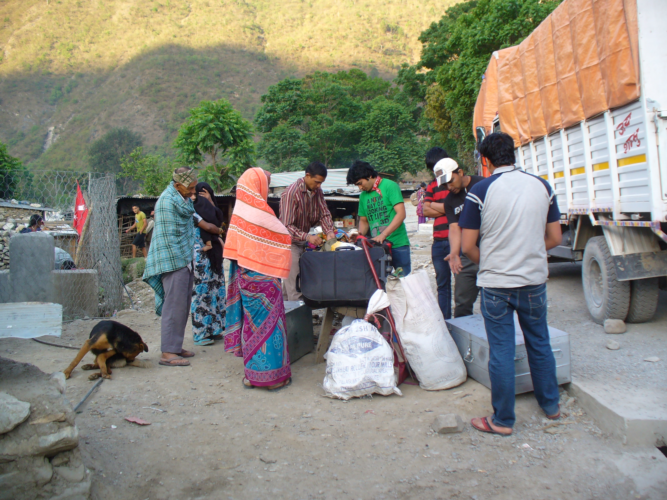 Deura, Bajhang district: Group of Nepali migrants coming back from Bangalore sort out their luggage after deboarding the overnight bus.